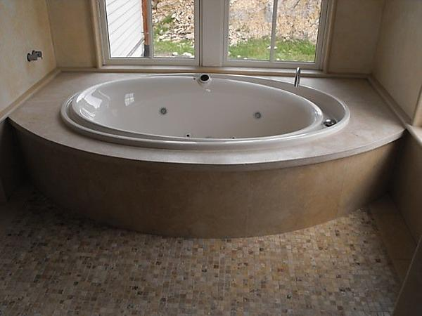 Curved jacuzzi front stone for Loft 213 stone wrap