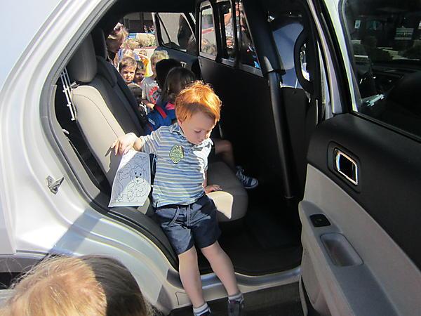 We all got to go through a police car