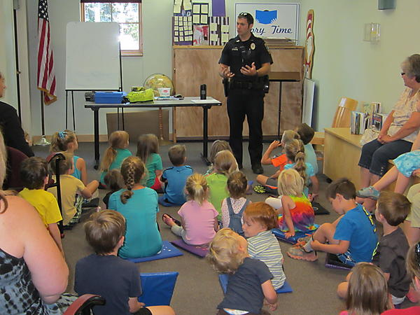 OFFICER TIM SCHUCH WAS OUR HERO TODAY THE KIDS REALLY LIKED HIS HANDCUFFS