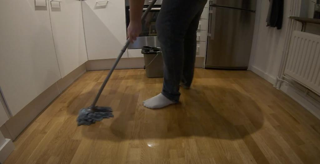Mopping the floor of a new apartment