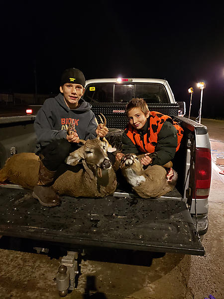 Two boy hunters first deer