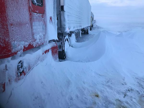 Deep Snow traps truck driver in road