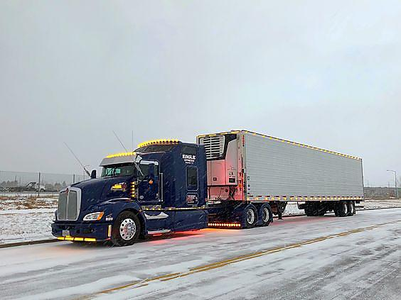 Truck driving in deep snow