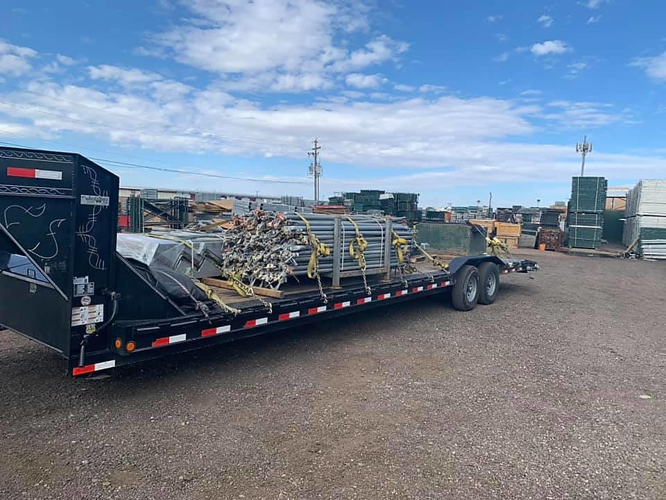 Flatbed loaded up with cargo using winch straps designed for tie down straps