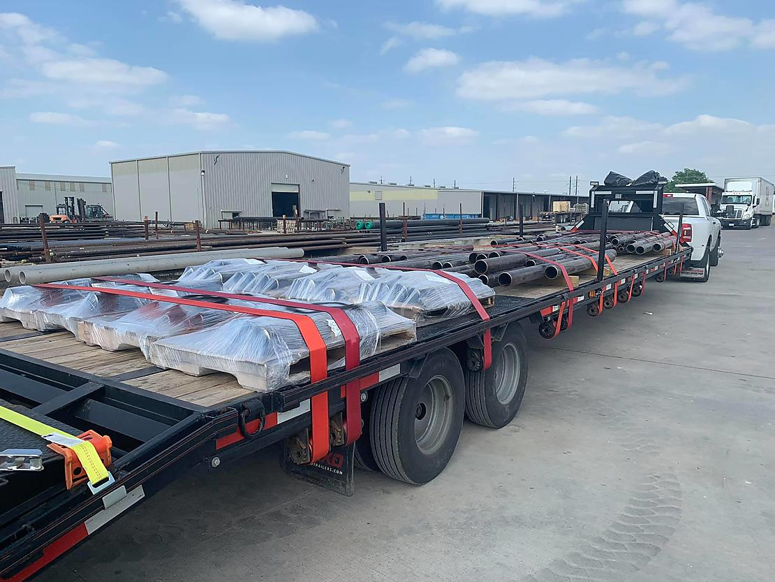 Flatbed Winch Straps in use on a flatbed trailer
