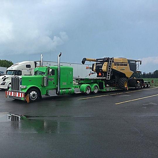 Heavy Hauler Flatbed Truck Driver Transporting Heavy Equipment