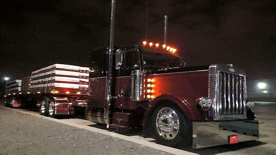 Semi Truck Loading Up at Night for the road with tie downs