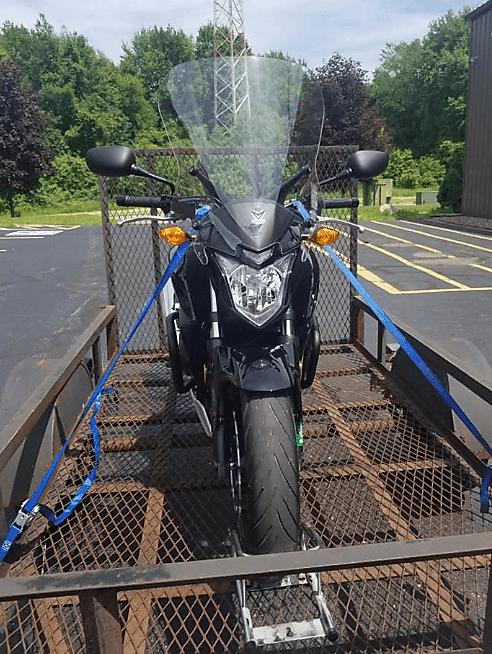Motorcycle Being Tied Down On A Motorcycle Trailer