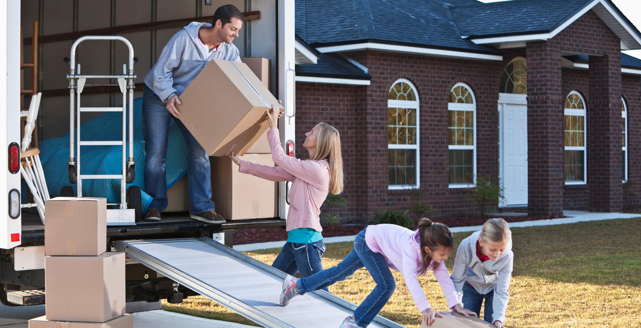Family loading a moving truck