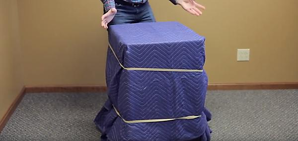 Moving Blankets Wrapped Around Fridge