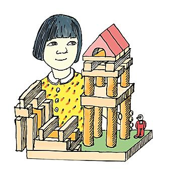 girl building with toy blocks