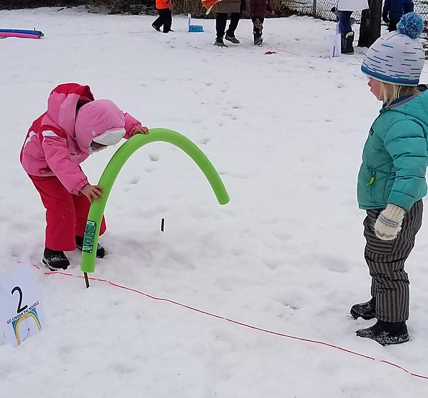 Two girls playing in snow