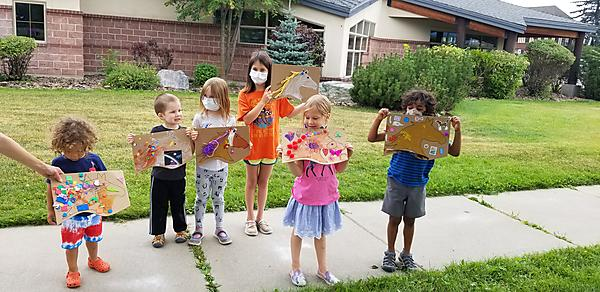 kids showing their artwork
