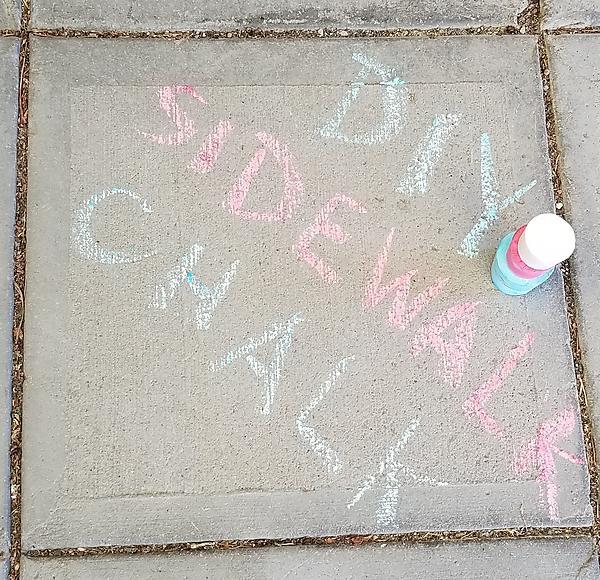 chalk words on sidewalk