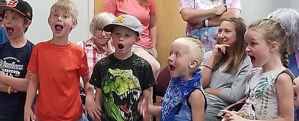children making big faces