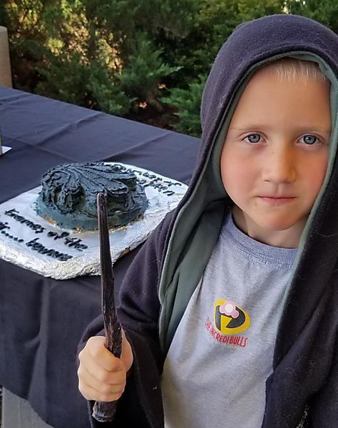 Edible Chamber of Secrets book with child wizard