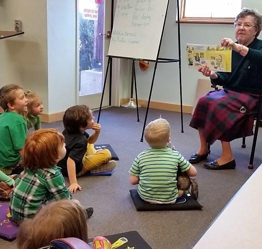 Story time reader and young listeners
