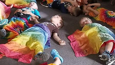 Toddlers napping on floor