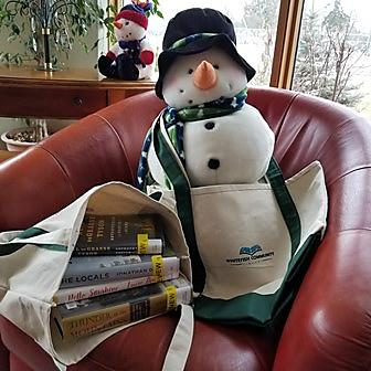 snowman with bag of books