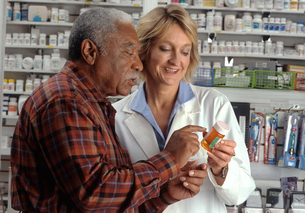 Man consults with pharmacist
